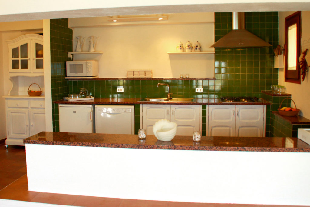 kitchen adjacent to the terrace with stunning views of the beach and sunset