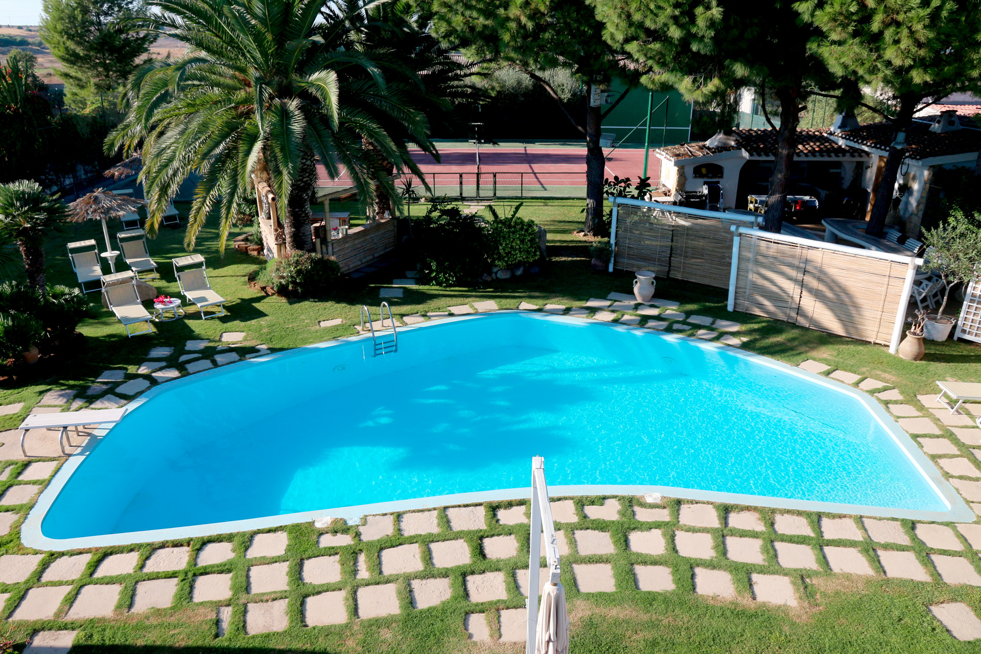large swimming pool - tennis court and part of the garden