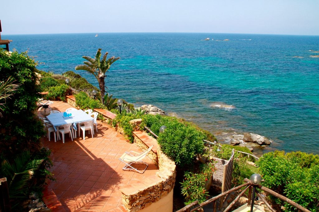 one of the terraces with barbecue and with stunning views of the bay, the beach and sunset front