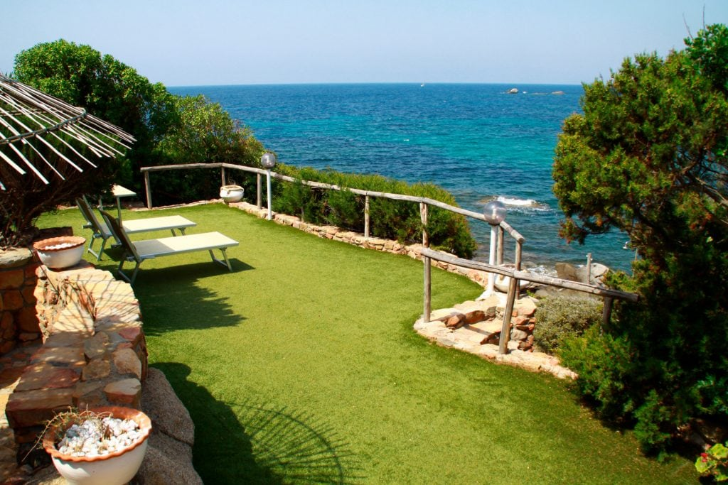 terrace with lawn and bar area, less than 6 meters from the water and facing the sunset